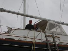 John and Susan aboard Tuppence