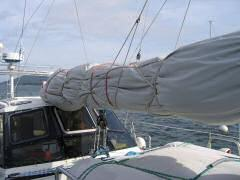 Sail cover lashed to the boom in preparation for storm