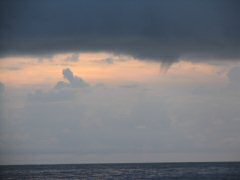 Waterspout receding into clouds