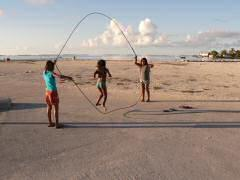Girls demonstrating coordination with Polynesian version of Double Dutch