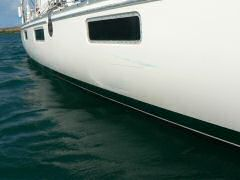 Scratches and paint left by fishing boat in collision