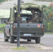 Fijian army truck with troops on board