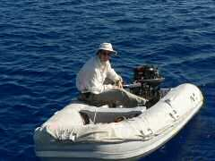 Ken with disassembled dinghy engine