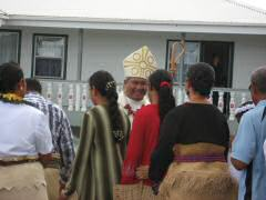 Charasmatic bishop greeting members of the congregation