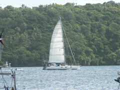 Sistership Wunderkind sailing out of Neiafu
