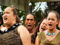 Singing traditional songs about Maori history